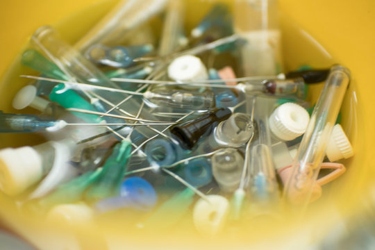 needles and syringes in disinfectant. disposal of medical needles and syringes and medical waste