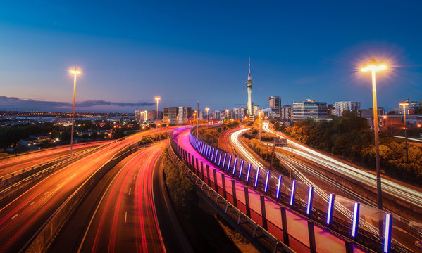Auckland City evening Shot on the bridge with lights of buildings and traffic, New Zealand