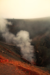 View of a crater on Mount Etna in Sicily, Italy on a cloudy summer day