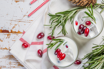White christmas margarita punch with rosemary on wood background