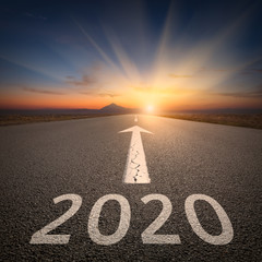 Driving to upcoming 2020 on open road at sunrise