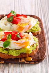 Toasts with avocado and fried egg