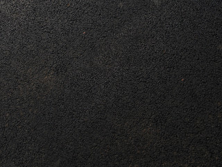 rough black leather from the workshop of the tailor - rough texture of the skin