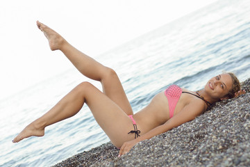 Woman on the beach in a swimsuit.