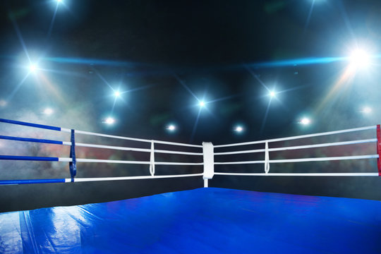 Empty boxing ring, view on corner with white ropes