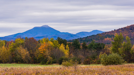 view of Camels Hump Mountain in fall foliage season, in Vermont