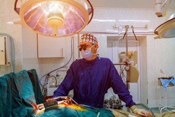 Surgery doctor in surgery center for interventions with surgery tools in surgeon operation for open heart