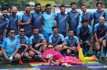 Soccer players of the Unicorns soccer team pose for a photo during the Champions LiGay, a gay soccer tournament in Sao Paulo
