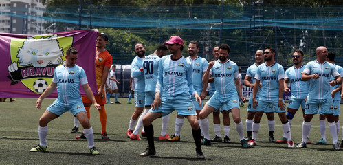 Soccer players of the Bravus soccer team pose for a photo during the Champions LiGay, a gay soccer tournament in Sao Paulo