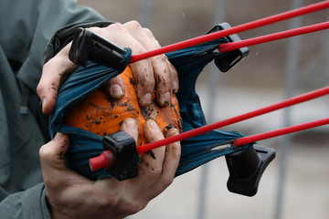A man prepares to launch a pumpkin using a giant slingshot in Ottawa