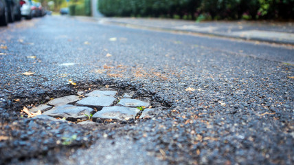 pothole on small street,