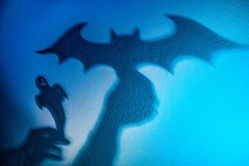 Shadow play. The shadow of a bat. Reflection shadows on the wall. Halloween Vampires.