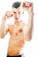 young handsome agressive man boxing isolared on white background