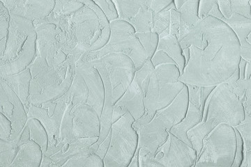 Relief stucco on the wall. Mint color. Close up