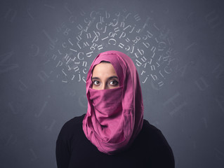 Young muslim woman wearing niqab with white alphabet letters above her head