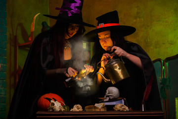 Picture of witches with pot of magical poison and steam