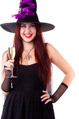 Image of laughing witch in black hat, with glass of champagne
