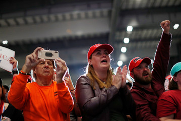 Supporters cheer as United States President Donald Trump attends a campaign rally in Pensacola