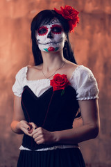 Halloween picture of woman with white make-up on her face, sewn on her mouth