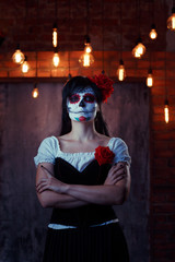 Halloween photo of woman with white make-up on face