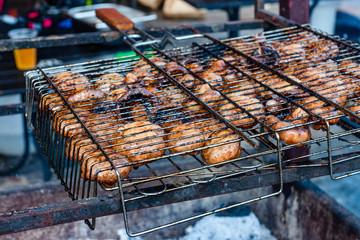 Champignons preparing in a barbecue grill on picnic