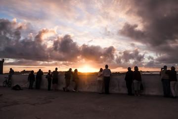 People standing at Skala de la Ville to watching sunset. Essaouira, Morocco.