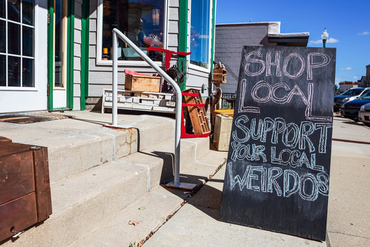 Shop local sign written in chalk, supporting small local business