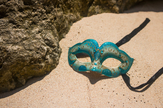 masquerade party mask on beach view