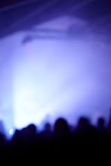 abstract photo, party, unrecognizable people, blue lights.