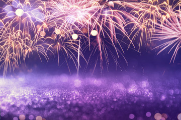 Fototapete - Purple fireworks and bokeh in New Year eve and copy space. Abstract background holiday.