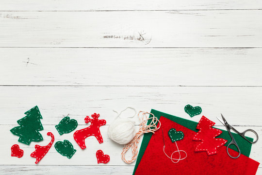 Do-it-yourself Christmas decorations on a wooden background with place for your text.
