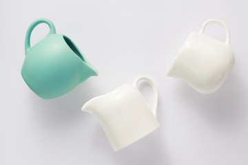 empty cream jug on white background