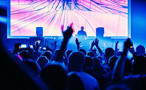 Dj set. Crowd of people dancing at concert