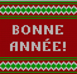 Knitted Lettering. Happy New Year. Text in French. Imitation knitting fabric. Multicolor knitting - letters and ornament.
