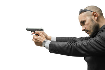 A man is aiming a gun. He is dressed in an Italian suit.