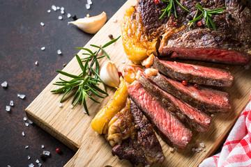 Foto op Canvas Steakhouse Grilled beef steak ribeye on wooden cutting board.