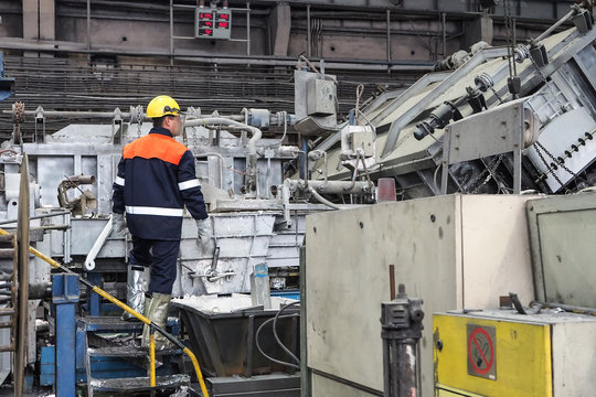 the smelter worker controls the aluminum smelting process
