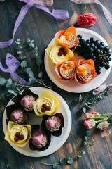 festive cupcakes on a table decorated with flowers