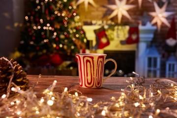 Christmas still life with mug and fireplace