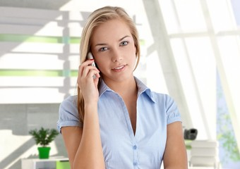 Young attractive female customer with mobile phone