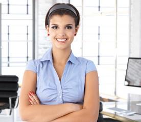Happy caucasian businesswoman at office desk