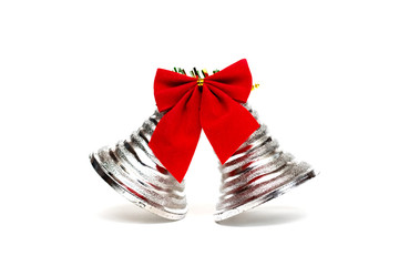 Two bells and a red bow on white background