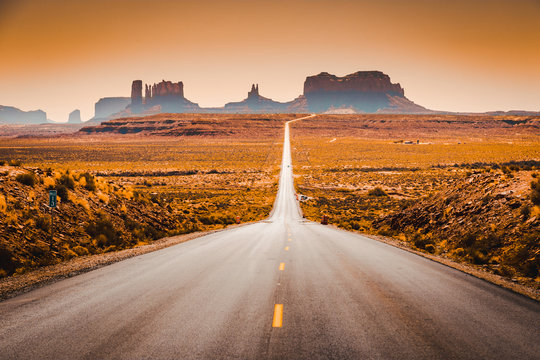 Classic highway view in Monument Valley at sunset, USA