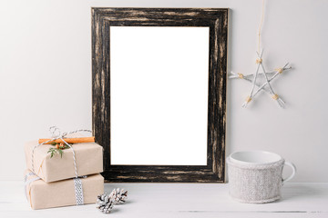 Empty white frame mock up. Black wooden frame mockup with christmas decorations on a white background