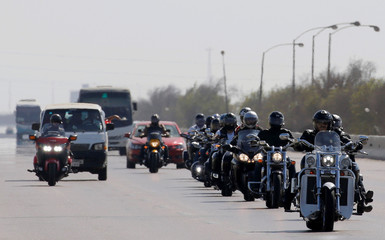 """Members of Egyptian motorcycle club """"Road Hammers"""" ride down a highway in Cairo, Egypt, as they travel across the country as part of their """"In love with Egypt"""" tour"""