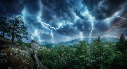 Zelfklevend Fotobehang Onweer Lightning thunderstorm flash in the mountains. Concept on topic weather, cataclysms (hurricane, Typhoon, tornado, storm)