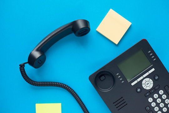 Deskphone, office and business concept. New ip phone with buttons and big display for communication without interference. Top view. Space for a text. Close up.