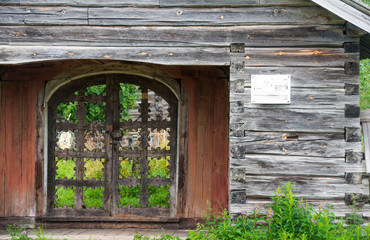Old wooden carved gate in wooden fence, Russia