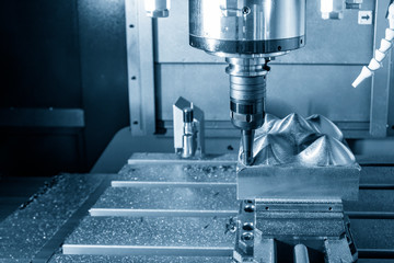 The  CNC milling machine cutting the mold part with the index-able ball end mill .The hi-Technology manufacturing process.
