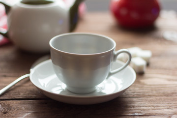 empty white tea Cup on the table